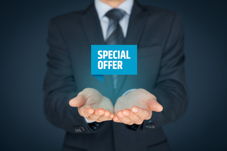 Special offer business model and marketing offer concept. Businessman hold virtual label with text special offer. Foto de archivo
