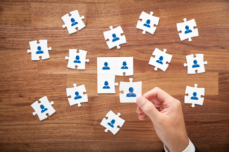 assemble: Assemble a team cencept. Business team, human resources cooperation, connection and unity concepts. Good team fit together like puzzle pieces. Stock Photo
