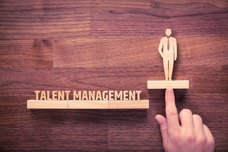 talent management: Talent management concept. Human resources recruiter helps employee with his personal development.