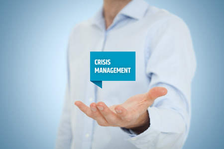 threatens: Crisis management service concept. Businessman hold virtual label with text crisis management.  Stock Photo
