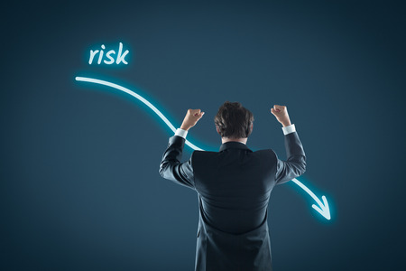 reduced: Reduced investment risk. Investor celebrate reduced risk.  Stock Photo