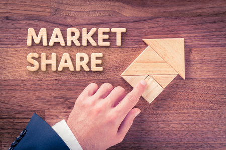 potentiality: Increase market share for your company. Businessman plan (predict) market share growth represented by arrow. Stock Photo