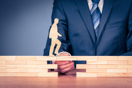 Customer care and support (help) and life insurance concept. Businessman representing company helps (support) customer (client) to overcome an obstacle. Problem solving with smart and simple solutions.