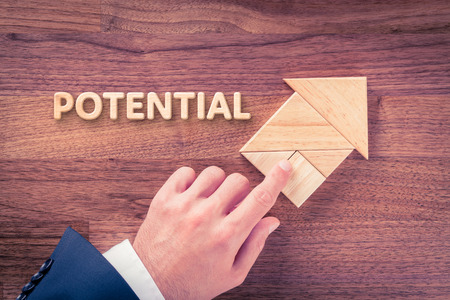 potentiality: Increase potential concept. Businessman plan potential growth represented by arrow. Stock Photo