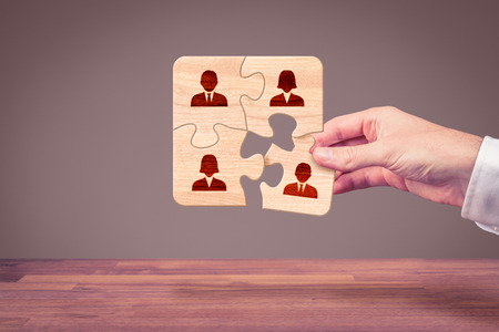 team cooperation: Assemble a team concept. Business team, human resources cooperation, connection and unity concepts. Good team fit together like puzzle pieces. Stock Photo