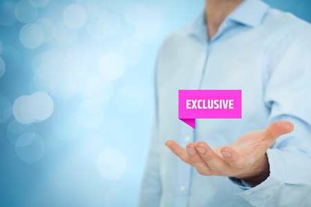 exclusively: Exclusive offer and exclusivity business model. Businessman hold virtual label with text exclusive. Right composition with bokeh in background. Stock Photo