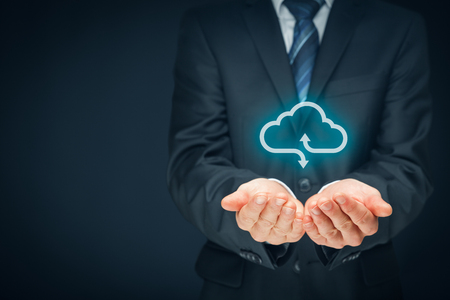 technologist: Cloud computing concept - connect devices to cloud. Businessman or information technologist with cloud computing icon. Stock Photo