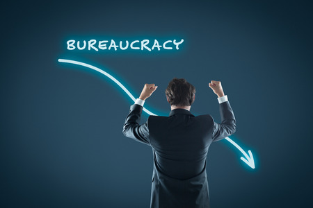 bureaucracy: Bureaucracy reduction concept. Businessman celebrate bureaucracy reduction.
