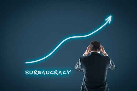 Bureaucracy growth concept. Businessman is frustrated by increasing bureaucracy. Stock Photo