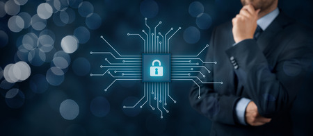 Information technology devices security concept. Businessman think about IT security - button with padlock icon in simplified design of chip connected with abstract devices represented by points.