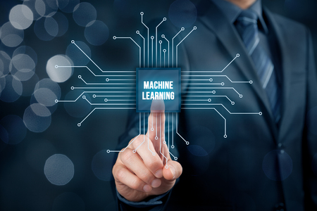 Machine learning data analysis concept. Businessman or programmer with abstract symbol of a chip with text machine learning connected with data represented by points. Archivio Fotografico
