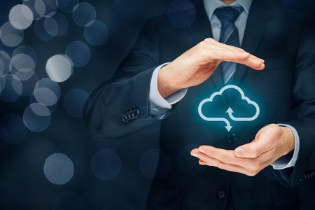 technologist: Cloud computing security concept - connect devices to cloud. Businessman or information technologist with cloud computing icon and protective gesture.