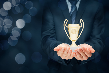 Business success, benchmarking and be number one on market concepts. Businessman hold cup representing success. Coach motivate to succeed. Stock Photo