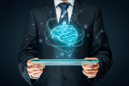 Artificial intelligence (AI), machine deep learning, data mining, expert system software, and another modern computer technologies concepts. Brain representing artificial intelligence and businessman holding futuristic tablet. Banque d'images
