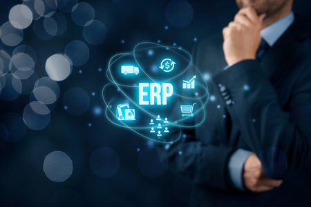 interpret: Enterprise resource planning ERP concept. Businessman think about ERP business management software for collect, store, manage and interpret business data about customers, HR, production, logistics, financials and marketing.