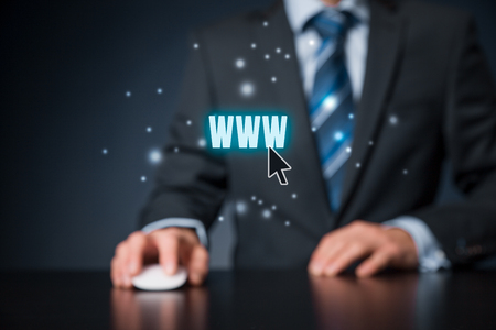 keywording: World wide web (www) - internet websites and SEO concepts. Businessman or programmer click on text www. Stock Photo