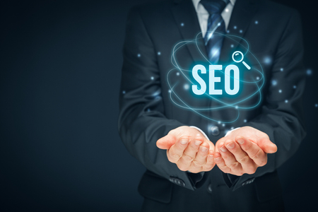 network people: Search engine optimization - SEO concept. Businessman or programmer is focused to improve SEO and web traffic. Stock Photo
