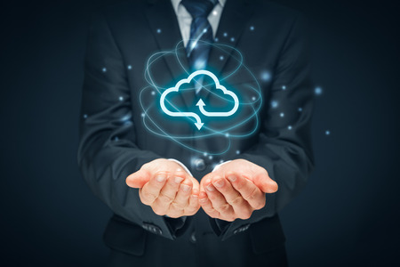 Cloud computing concept - connect to cloud. Businessman or information technologist with cloud computing icon. 免版税图像