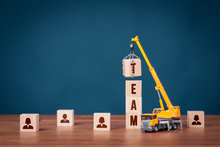 Build team, hire and recruitment concepts. Recruiter represented by crane complete team.
