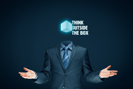 open minded: Think outside the box concept. Open minded businessman with box and text think outside the box.