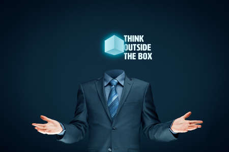 Think outside the box concept. Open minded businessman with box and text think outside the box.