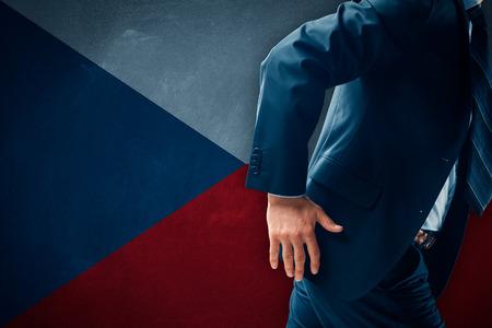Czexit concept. Businessman (financier, bank employee, CEO, manager) run away (escape) from Czech Republic.