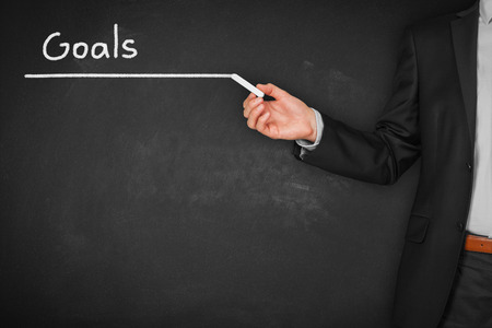 Businessman plan goals for its business. Title page or background for business slide show for presentations.