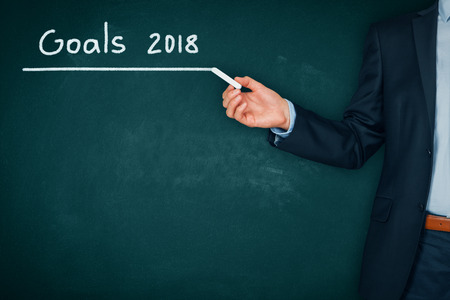 Businessman plan goals for 2018. Business new year goals and targets concept.