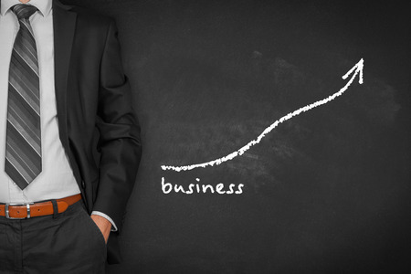 Businessman with hands in passive gesture and increasing graph with text business. Banque d'images