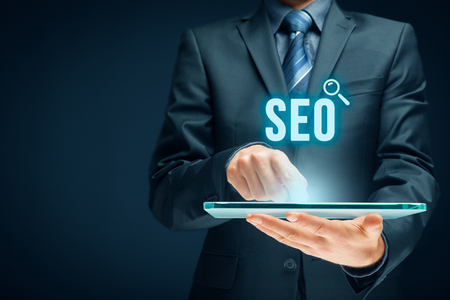 Search engine optimization - SEO concept. Businessman or programmer is focused to improve SEO and web traffic. Banque d'images