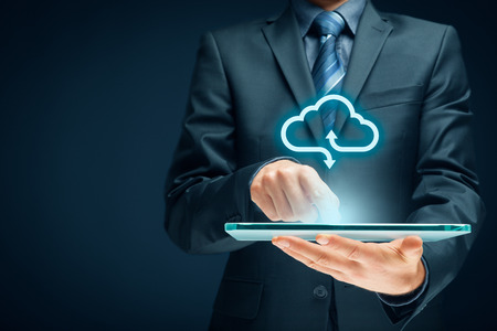 Cloud computing concept - connect devices to cloud. Businessman or information technologist with cloud computing icon. Banque d'images