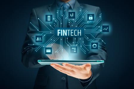 Fintech (financial technology) concept. Business person with tablet and fintech illustration. Reklamní fotografie