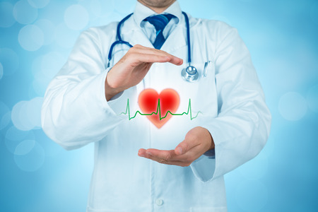 Protect health (healthcare) and heart problems prevention (cardiology) concept. Cardiologist or general practitioner doctor with protective gesture and symbol of heart and ECG heartbeat. Medical insurance concept.