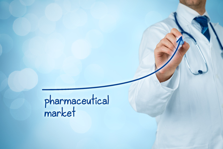 Growing pharmaceutical market concept. Businessman draw increasing graph illustrating growing pharma market. Banque d'images