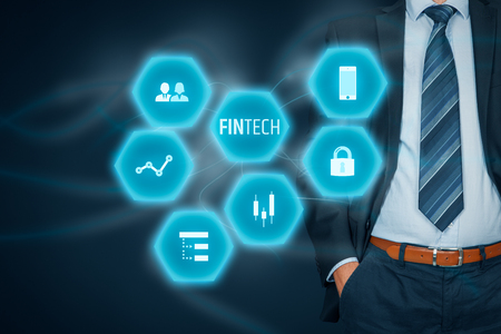 Fintech (financial technology) concept. Business person with fintech text and financial icons.