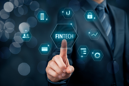 Fintech (financial technology) concept. Business person click on fintech text and financial icons.