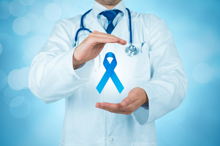 Prostate cancer prevention concept, peace and genetic disorder awareness - practitioner doctor with protective gesture and blue ribbon. Foto de archivo