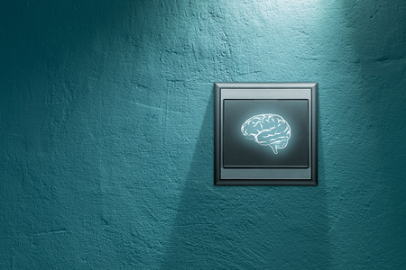 Turn on creativity and brainstorming concepts. Switch on wall with symbol of brain.