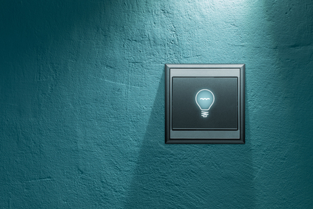 Turn on creativity concept. Switch on wall with symbol of light bulb. Banque d'images