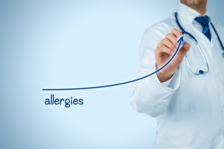 Allergies increasing concept. Doctor (medical practitioner) draw growing graph of increasing number of allergies.