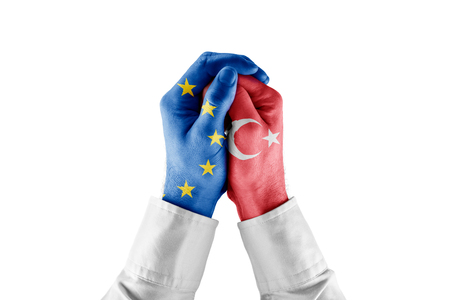 Turkey and EU concept. Hands with EU and Turkey flags and protective and unity gestures.