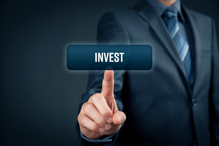 Invest concept. Investor (trader) click on button with text invest.