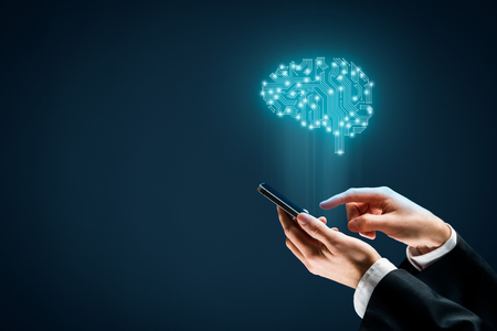 Artificial intelligence (AI), machine deep learning, data mining, and another modern computer technologies concepts. Brain with PCB design representing AI and businessman holding smart mobile phone.