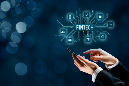 Fintech (financial technology) concept. Business person with fintech text and financial icons and smart phone.