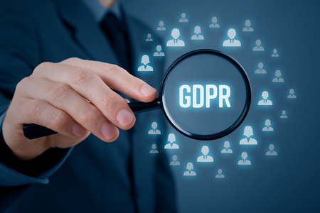 GDPR (general data protection regulation) concept. Businessman or IT technologist focus on GDPR problematics. Sensitive personal information represented by icons of people. Archivio Fotografico