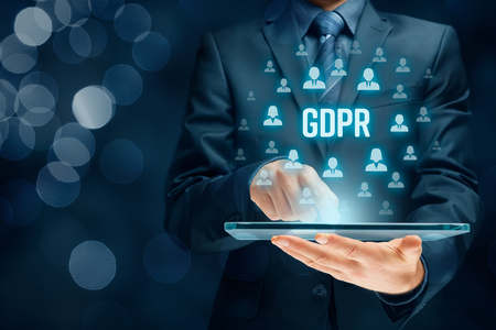 GDPR (general data protection regulation) concept. Businessman or IT technologist with text GDPR and icons of people. Archivio Fotografico