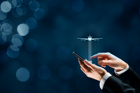 Air ticket booking on smartphone app or online travel insurance concepts. Person with smart phone and symbol of a plane. Stock Photo