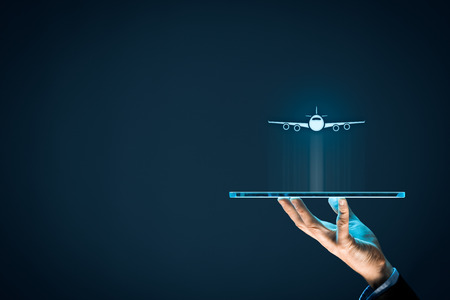 Air ticket booking on digital tablet app or online travel insurance concepts. Person with digital tablet and symbol of a plane.
