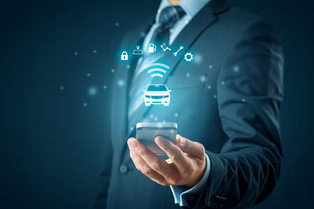 Intelligent car, intelligent vehicle and smart cars concept with smart phones. Symbol of the car and information via wireless communication about security, parking location, fuel, drive analysis, service and car settings. Stock Photo