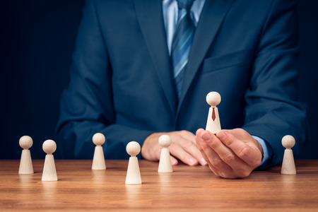 Successful team leader (manager, CEO, market leader) and another business leadership concepts. Human resources officer select team manager. Stock Photo